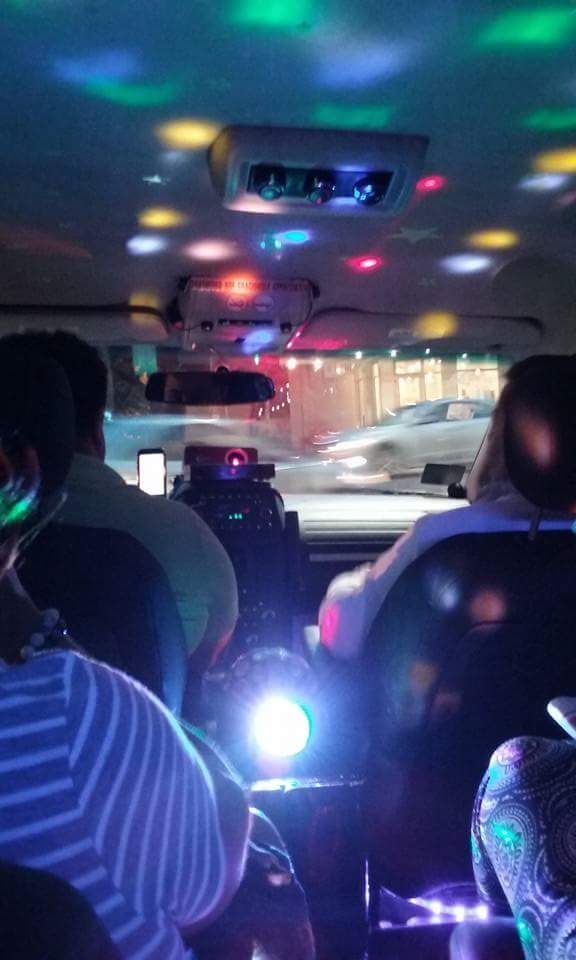 The inside of the Uber with the strobe lights & karaoke.