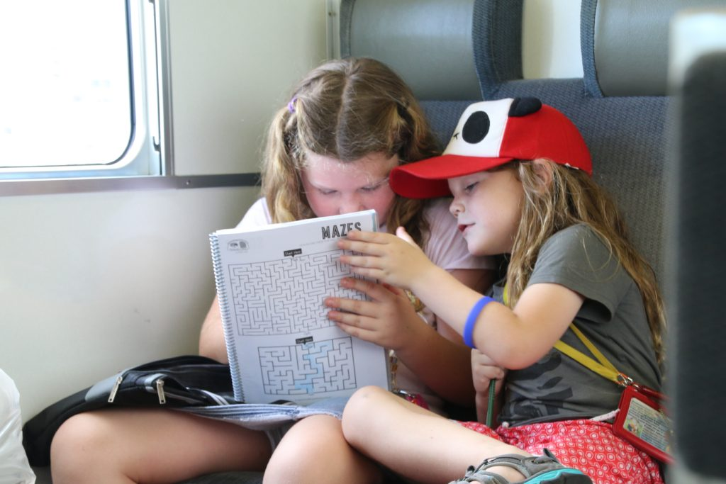 My youngest two kids Pepper and Woody using their travel journal and wearing their ID cards.