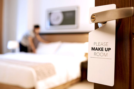 housekeeper in a hotel room